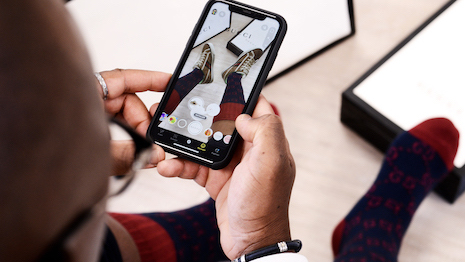 Snapchat users can now use AR tech to virtually try on Gucci footwear to see if they like the merchandise and then have the option to buy it directly from that location. Image courtesy of Gucci